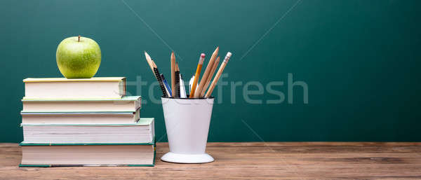 Green Apple On Top Of Stacked Books Stock photo © AndreyPopov