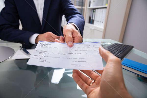 Affaires chèque main verre bureau Finance Photo stock © AndreyPopov