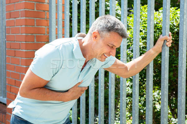 Man Having Heart Stroke Stock photo © AndreyPopov