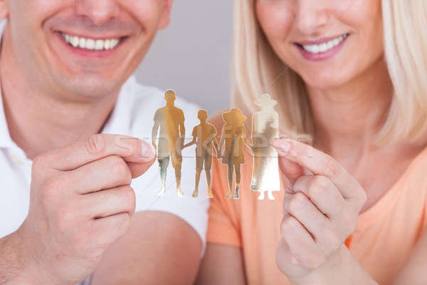 Couple holding family figure cut-out Stock photo © AndreyPopov