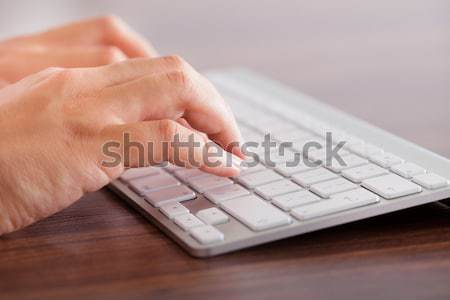 Close-up Of Male Hands Typing On Computer Keyboard Stock photo © AndreyPopov