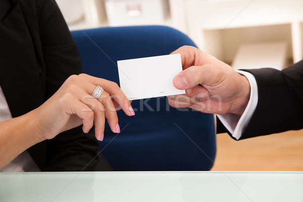 Man handing over a business card Stock photo © AndreyPopov