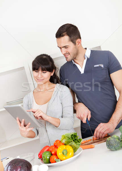 Young couple cooking at home Stock photo © AndreyPopov