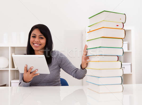 Woman Avoiding Books And Using Tablet Stock photo © AndreyPopov