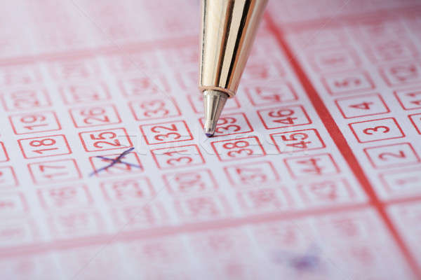 Pen Marking Numbers On Lottery Ticket Stock photo © AndreyPopov