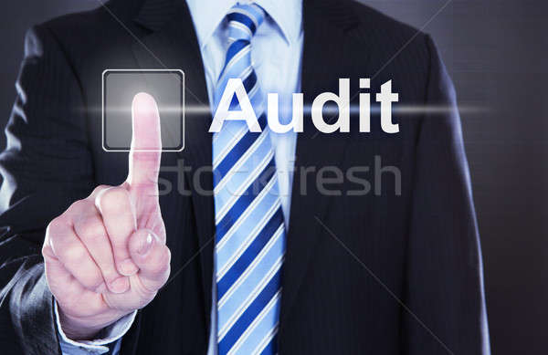 Businessman Touching Audit Button Stock photo © AndreyPopov