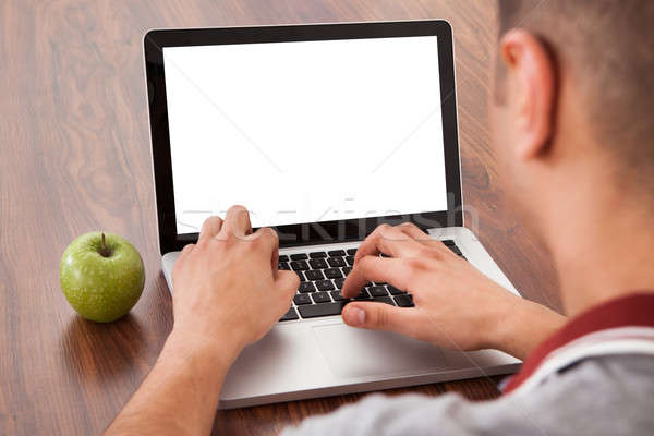 Male College Student Using Laptop Stock photo © AndreyPopov