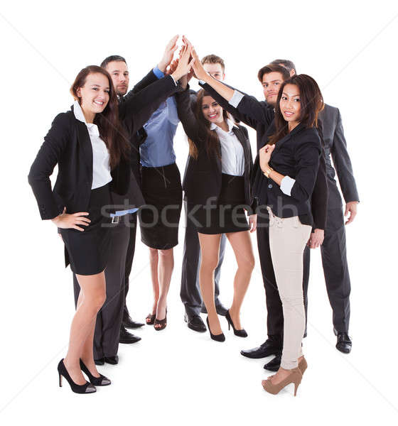 Businesspeople making high five gesture Stock photo © AndreyPopov