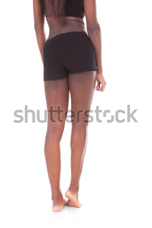 Low section rear view of young African American woman standing Stock photo © AndreyPopov