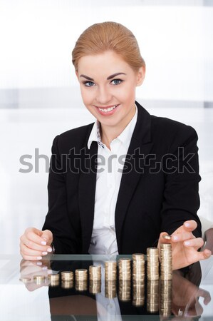 Businesswoman Stacking Coins Stock photo © AndreyPopov
