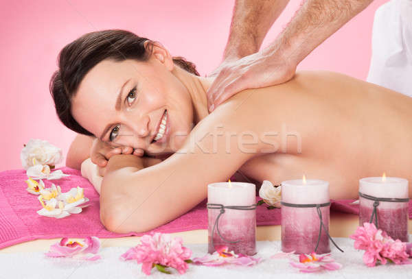Woman Receiving Back Massaging In Spa Stock photo © AndreyPopov