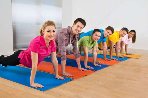 Group Of People Doing Push Ups Stock photo © AndreyPopov