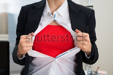Businesswoman Tearing Her Shirt Showing Red Costume Stock photo © AndreyPopov