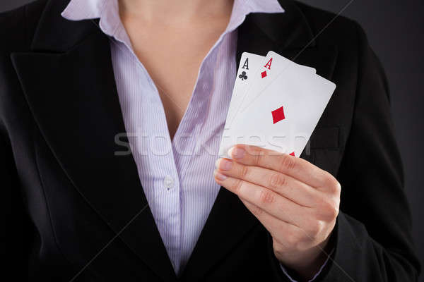 Businessperson Holding Poker Card Stock photo © AndreyPopov