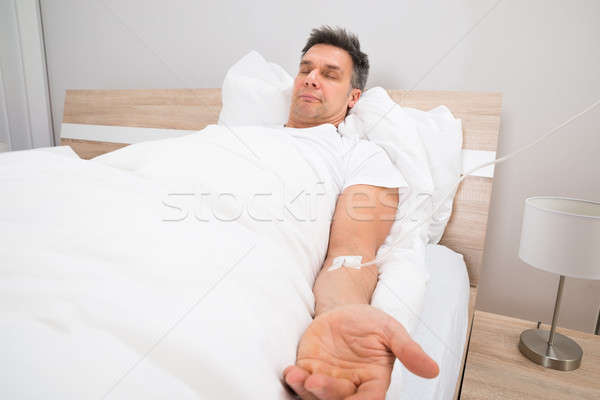 Patient Resting On Bed With Iv Drip Stock photo © AndreyPopov