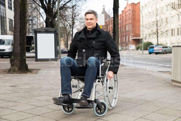 инвалидов человека коляске город портрет улыбаясь Сток-фото © AndreyPopov