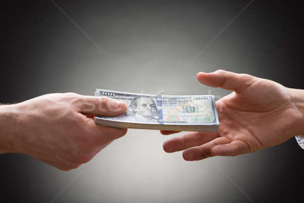 Two People Hands With Money Stock photo © AndreyPopov