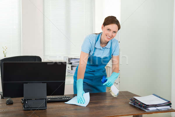 Worker Cleaning Desk With Rag Stock photo © AndreyPopov