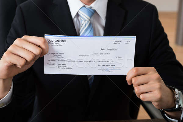 Close-up Of Businessman Showing Cheque Stock photo © AndreyPopov