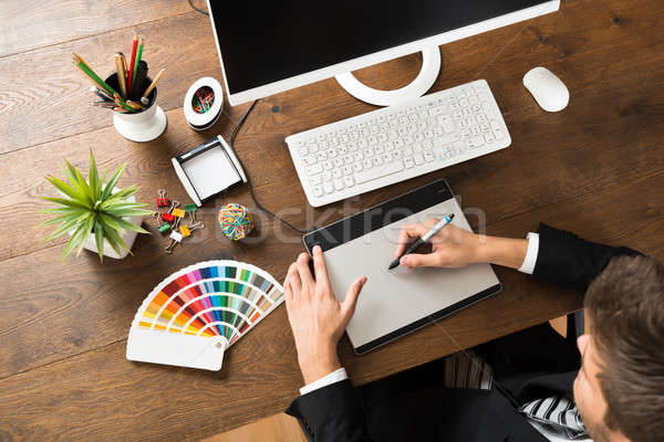 Male Designer Using Digital Graphic Tablet Stock photo © AndreyPopov
