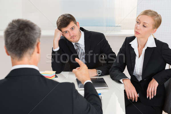 Argumento local de trabalho grupo três gerente Foto stock © AndreyPopov