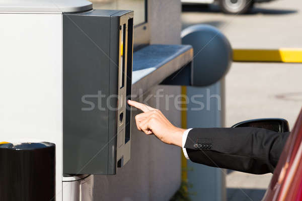 Person Using Parking Machine To Pay For Parking Stock photo © AndreyPopov