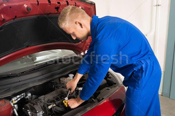Young Mechanic Repairing Car Stock photo © AndreyPopov