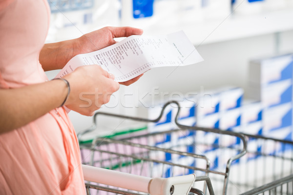 Woman Holding Receipt In Supermarket Stock photo © AndreyPopov