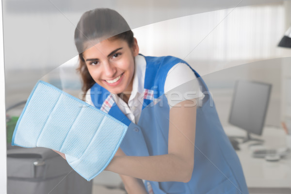 Happy Female Worker Cleaning Glass Window With Rag Stock photo © AndreyPopov