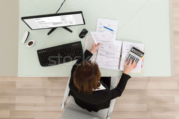 Businesswoman Calculating Financial Report Stock photo © AndreyPopov
