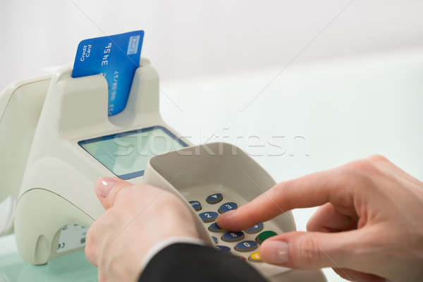 Woman Pressing Button On Credit Card Machine Stock photo © AndreyPopov