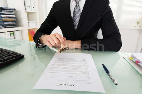 Affaires contrat papier main Photo stock © AndreyPopov