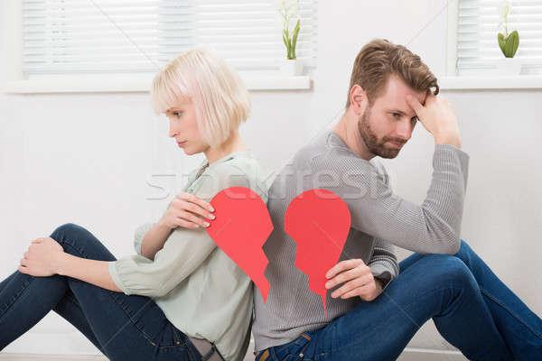 Szomorú pár tart piros összetört szív ül Stock fotó © AndreyPopov