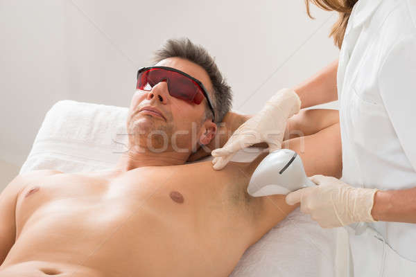 Beautician Giving Hair Removal Treatment To Man Stock photo © AndreyPopov