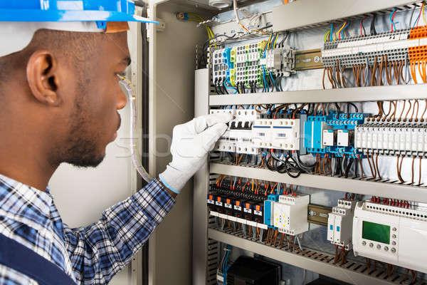Technician Checking Fusebox Stock photo © AndreyPopov