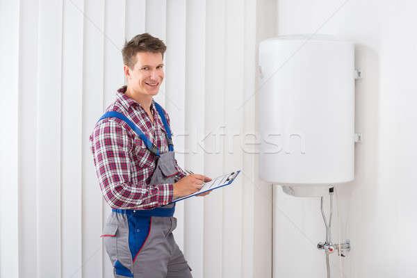 Foto stock: Encanador · elétrico · jovem · masculino · clipboard