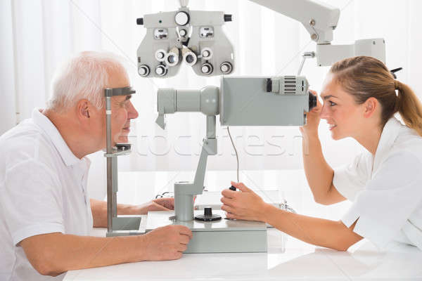 An Optometrist Doing Vision Testing For Male Patient Stock photo © AndreyPopov