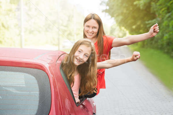 Mother And Daughter Leaning Outside Car Stock photo © AndreyPopov