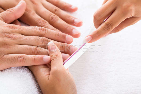 Manicurist Filing Person's Nails Stock photo © AndreyPopov