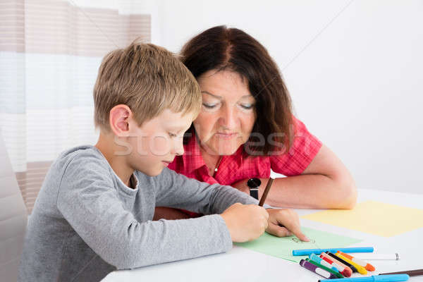 Grandson Drawing On Colorful Paper At Home Stock photo © AndreyPopov