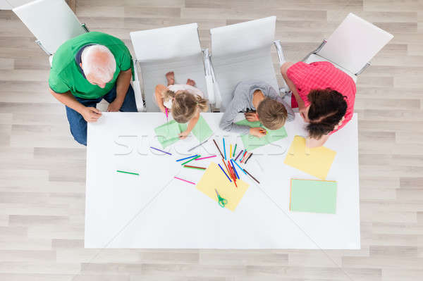 Multi Generation Family Doing Arts And Crafts Together Stock photo © AndreyPopov