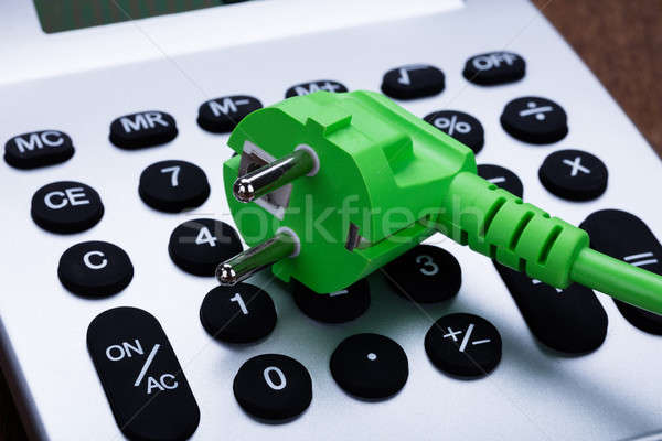 Electric Cable On Calculator Button Stock photo © AndreyPopov