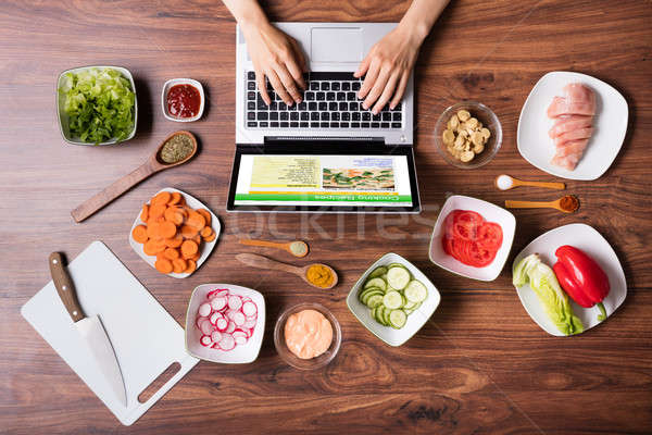 High Angle View Of Woman Using Laptop In Kitchen Stock photo © AndreyPopov