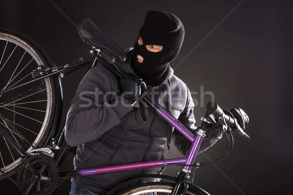 Person Wearing Balaclava Stealing A Bicycle Stock photo © AndreyPopov