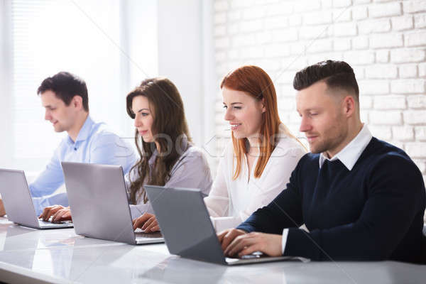 Group Of Business People Using Laptop Stock photo © AndreyPopov