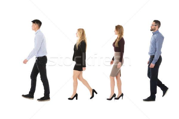 Homme Homme collège élèves marche rangée Photo stock © AndreyPopov