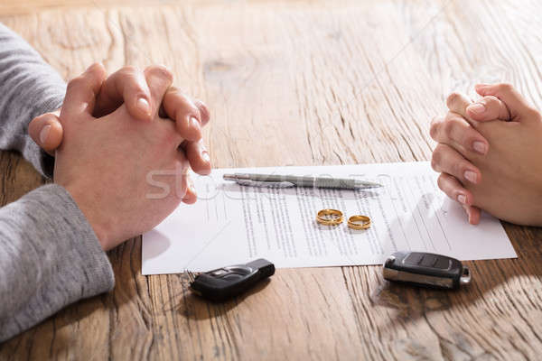 Couple's Hand On Divorce Agreement Wit Car Keys Stock photo © AndreyPopov