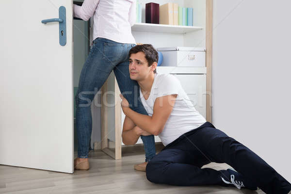 Man Stopping The Woman From Leaving Her Stock photo © AndreyPopov