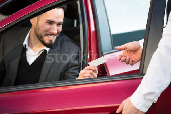 Valet Giving Receipt To Businessperson Sitting Inside Car Stock photo © AndreyPopov