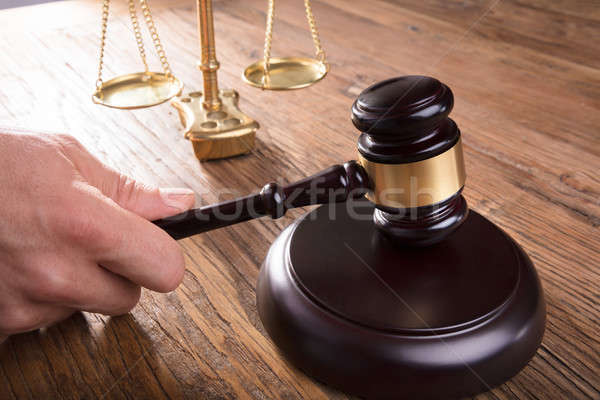 Judge Hitting Mallet By Justice Scale On Wooden Table Stock photo © AndreyPopov